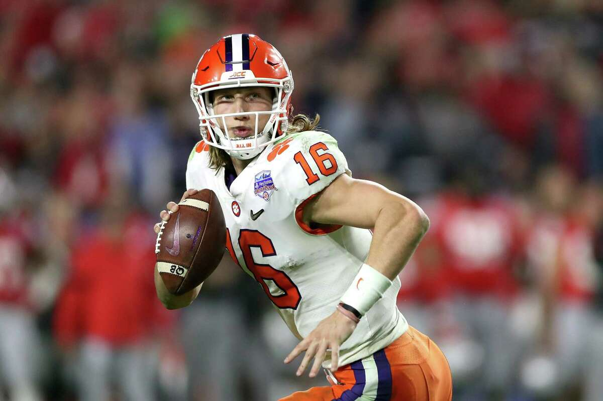 GLENDALE, ARIZONA - DECEMBER 28: Trevor Lawrence #16 of the Clemson Tigers looks to pass against the Ohio State Buckeyes in the second half during the College Football Playoff Semifinal at the PlayStation Fiesta Bowl at State Farm Stadium on December 28, 2019 in Glendale, Arizona. (Photo by Matthew Stockman/Getty Images)