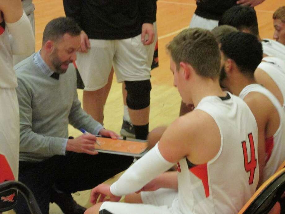 Terryville coach Mark Fowler plots the upset by his Kangaroos over defending Berkshire League champion Wamogo Tuesday night at Terryville High School. Photo: Peter Wallace / Hearst Connecticut Media