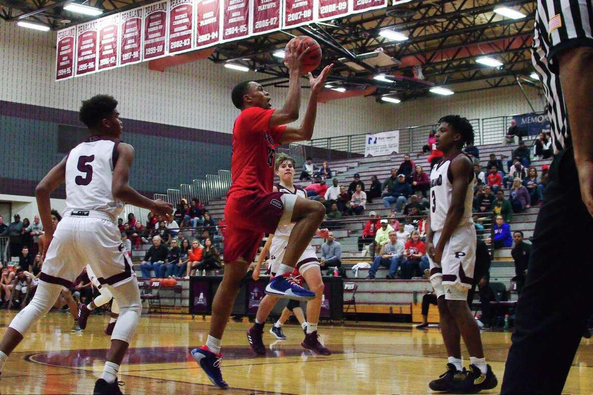 Dawson's Conlie Christmas (25) lays up a shot over Pearland's A.J. Tyler (3) Tuesday at Pearland High School.