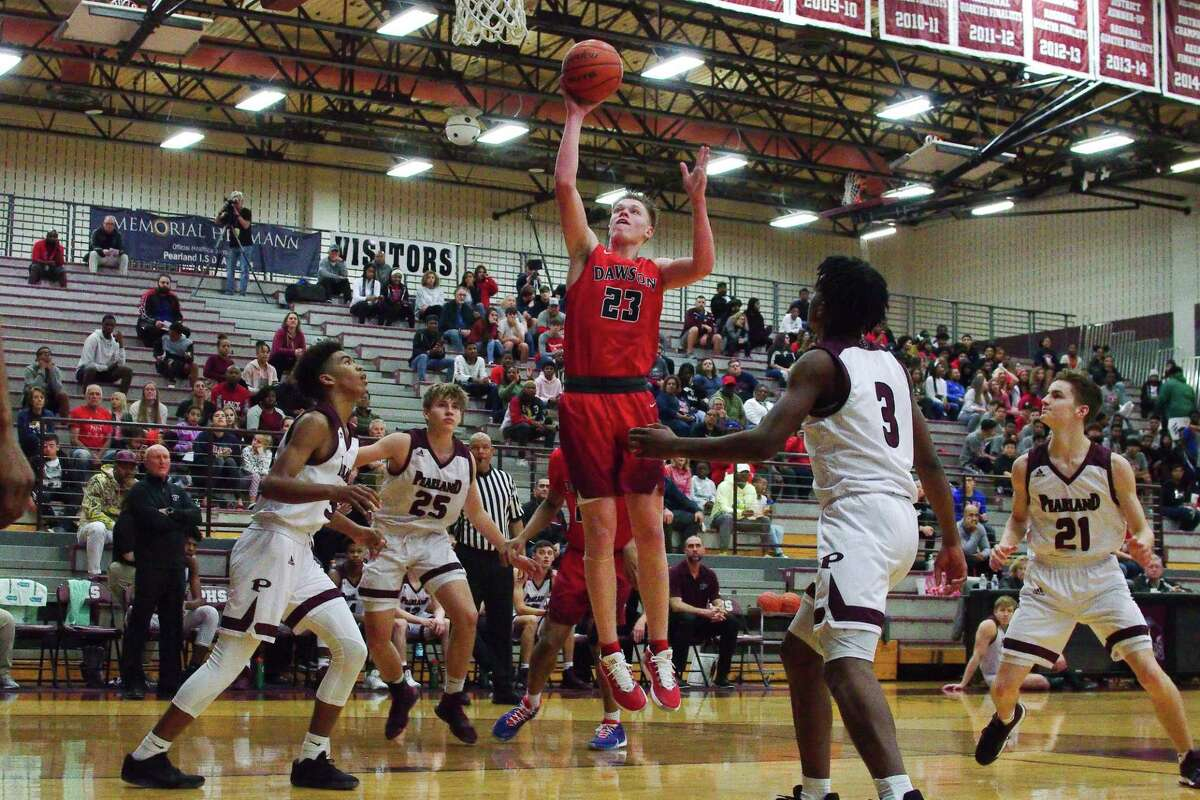 Dawson's Hayden Windsor (23) puts up a shot against Pearland Tuesday at Pearland High School.
