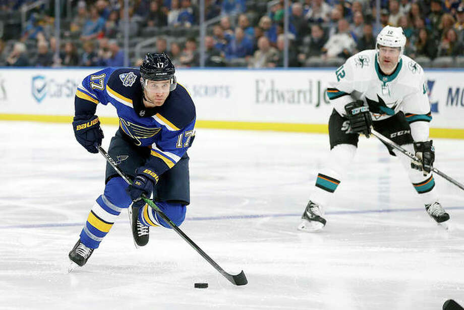 The Blues' Jaden Schwartz (17) brings the puck up the ice as San Jose's Patrick Marleau watches during the second period Tuesday in St. Louis. Photo: AP Photo