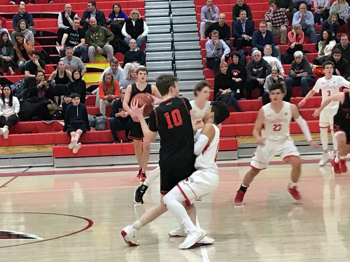 The New Canaan boys basketball team beat Greenwich, 66-49, on January 7, 2020, in Greenwich.