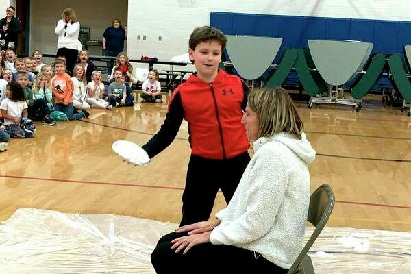 Zac Fritz prepares to place a pie right in the face of Laker Elementary School Principal Jill VerBurg. (Courtesy Photo)