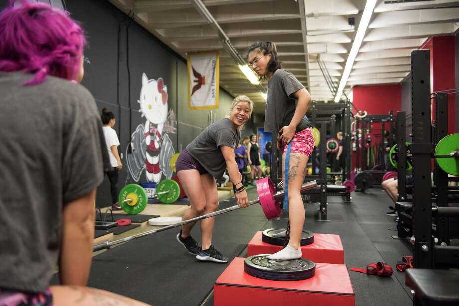 For the ladies at An Iron Movement, in addition to the community and inclusiveness, it's this sense of progress that keeps them coming back, along with the knowledge that the community has your back no matter what. Photo: Blair Heagerty / SFGate