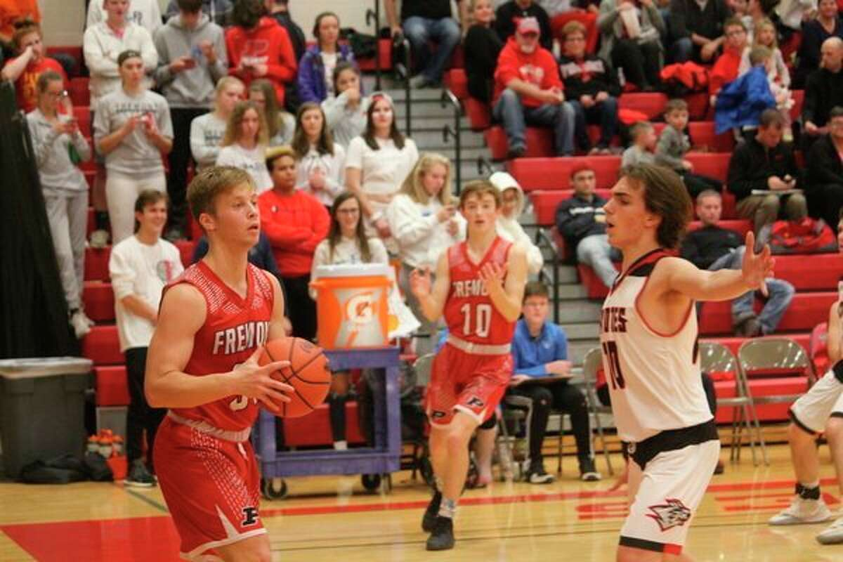 Reed City's Jason Thomas (right) applies the defensive pressure against Fremont earlier this season. (Herald Review photo/John Raffel)