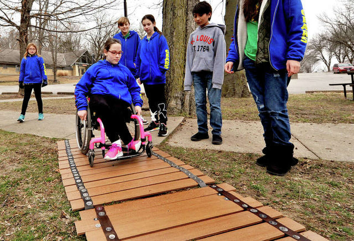 Anne Conness rolls her wheelchair across the Passable Path she and her teammates created. Conness is one member of a robotics team from St. John Neumann Catholic School in Maryville.