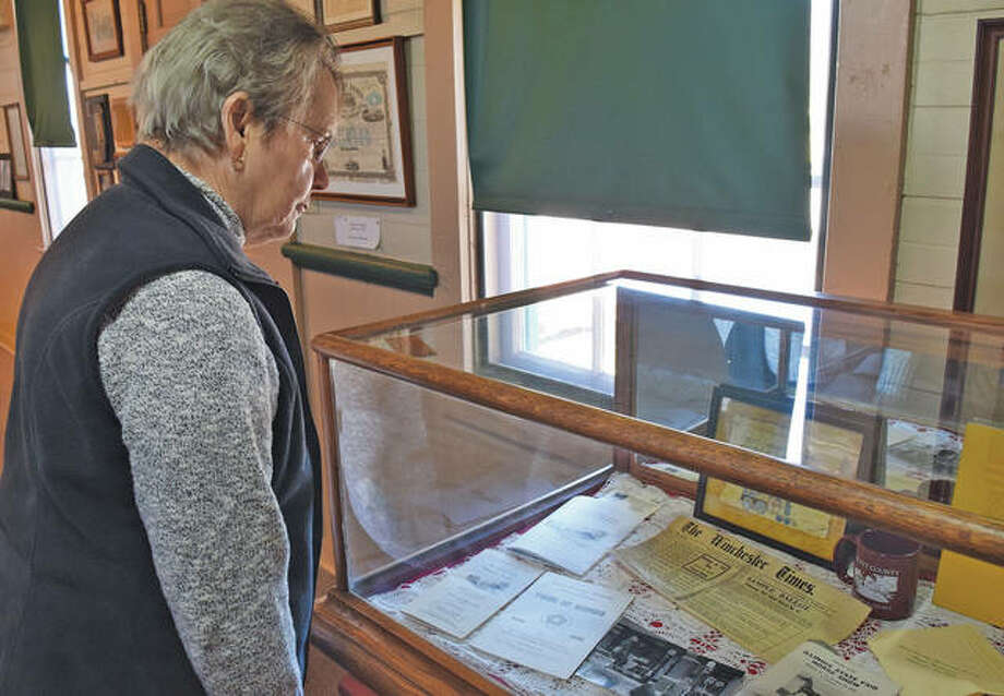 Scott County Historical Society member Merrilyn Fedder looks at historical artifacts inside the Winchester Depot. There have been several misconceptions that the historical society is no longer active and no longer owns the depot. Photo: Marco Cartolano | Journal-Courier