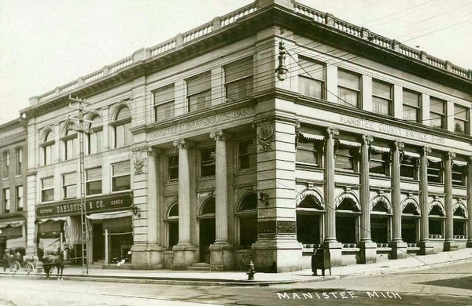 The Manistee County Savings Bank building located on River Street in Manistee is shown in this early 1900 photograph.
