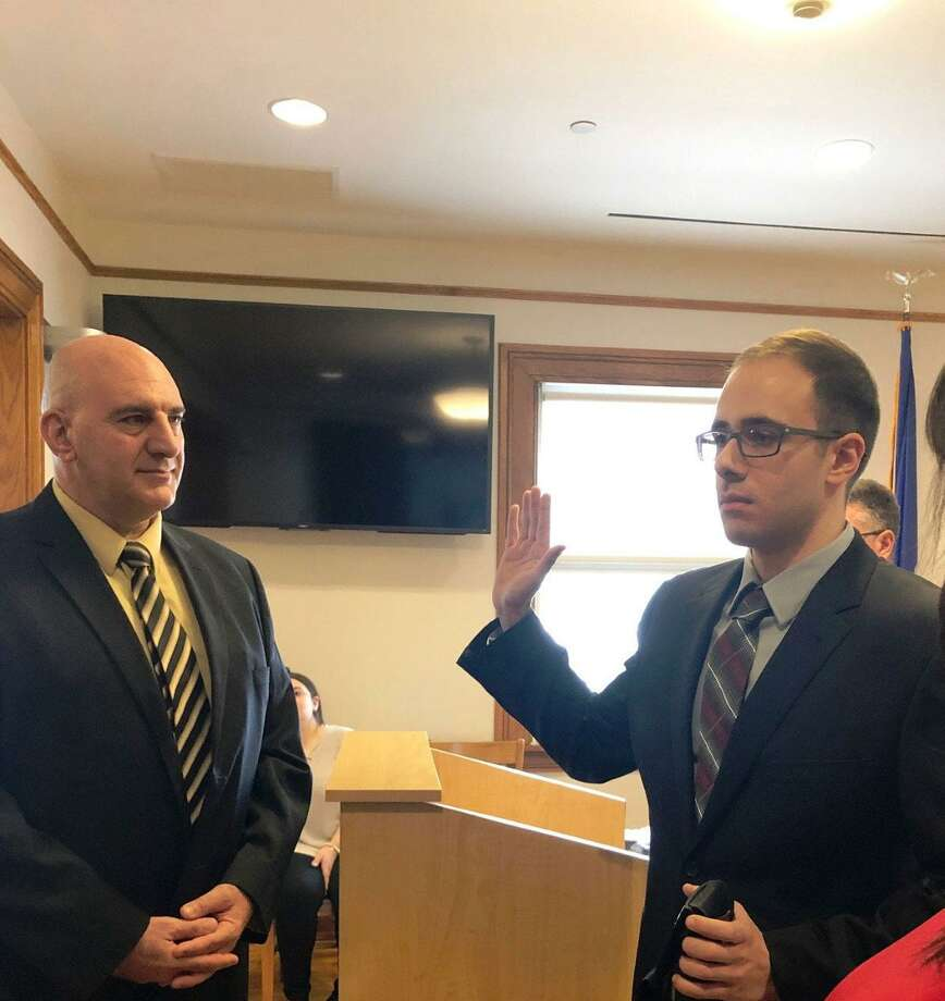 New Canaan's newest police officer, Nicholas Falbo, is sworn in on Tuesday, Jan. 7. Photo: New Canaan Police Department / Contributed Photo