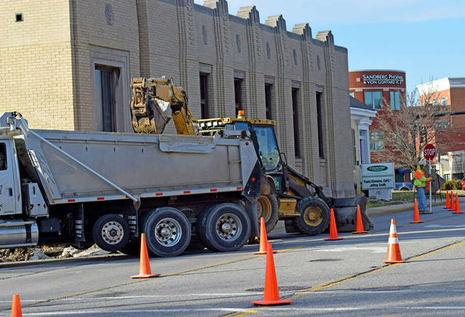 Construction workers began doing preparation work in front of 119 S. Main St. Tuesday, directing southbound Main Street traffic into the center left-turn lane. Photo: Tyler Pletsch|The Intelligencer