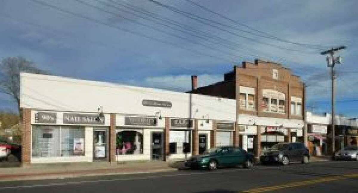 Property in downtown Shelton at 515 Howe Ave., a site approved for apartments and retail space, is on the market.