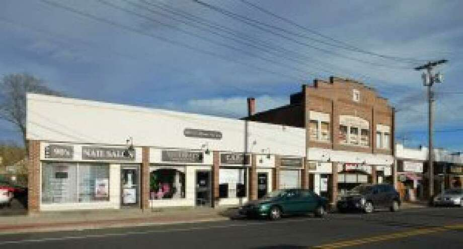 Property in downtown Shelton at 515 Howe Ave., a site approved for apartments and retail space, is on the market. Photo: Contributed Photo / Connecticut Post
