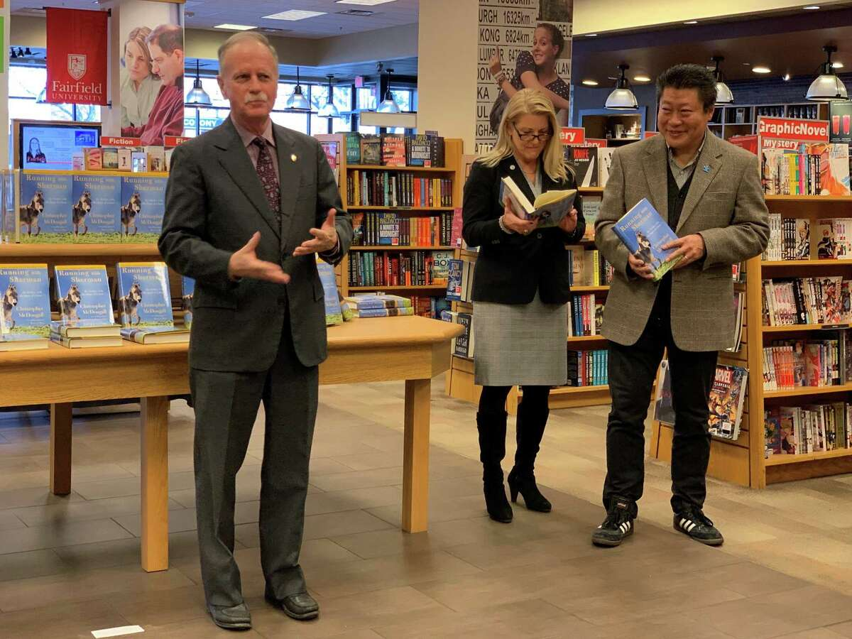 James Fitzpatrick, left, assistant vice president at Fairfield University, with First Selectwoman Brenda Kupchick and State Senator Tony Hwang at the One Book One Town event Tuesday.