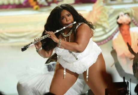 Erin Nolen writes that Lizzo's twerking - and more broadly, her unabashed embrace of her body - is an act of resistance in a society that negatively objectifies Black women and promotes submission to the White, thin ideal. This June 23, 2019 file photo shows Lizzo playing the flute at the BET Awards in Los Angeles. Lizzo has been named Entertainer of the Year by The Associated Press.