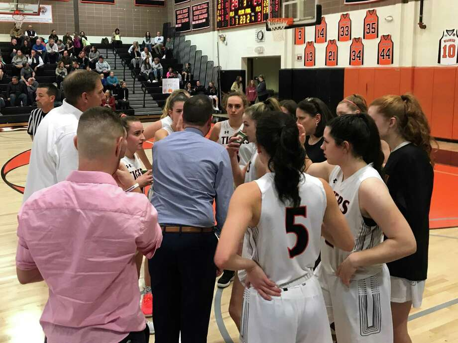 Ridgefield coach Rob Coloney talks to his players during Tuesday night's game against Stamford. Photo: Scott Ericson / Connecticut Post