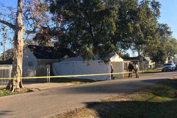 A covered walkway has been set up at the south Houston home that was the scene of a botched drug raid that left two dead and five officers injured nearly a year ago.
