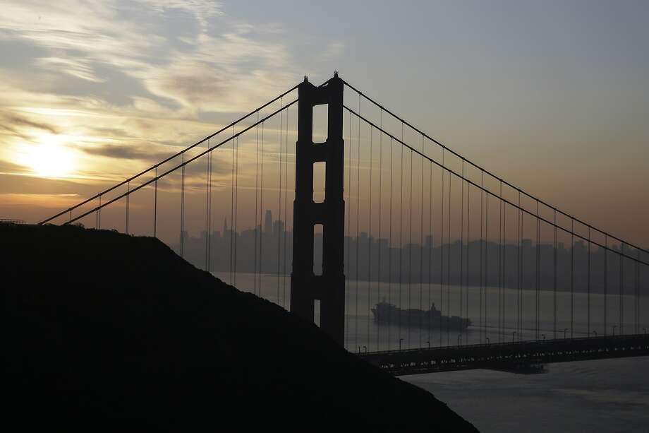 FILE - In this Oct. 28, 2019, file photo a Matson container ship passes the Golden Gate Bridge in Sausalito, Calif. On Friday, Dec. 20, the Commerce Department issues the third estimate of how the U.S. economy performed in the July-September quarter. (AP Photo/Eric Risberg, File) Photo: Eric Risberg, Associated Press