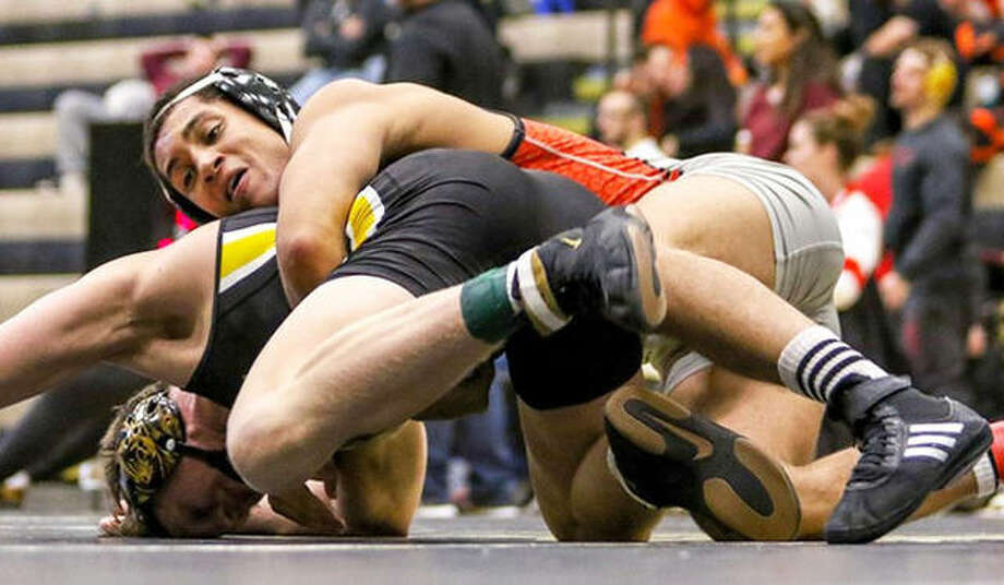 SIUE's Justin Ruffin (top) was a double winner Tuesday in duals against Kent State and Clarion. He is shown in action earlier this season. Photo: SIUE Athletics