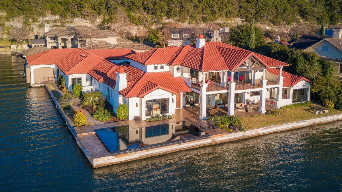 Address: 4104 Shimmering Cove City: Austin Building Square feet: 7,775 Price: $9,995,000 Key Features: 200 feet of Lake Austin waterfront, media room, game room, EV charging station and two jet skis slips with hydraulic lifts A spectacular 7,775 square foot waterfront estate outside Austin, Texas with an outdoor terrace and boathouse that is essentially a resort. Home link: http://shimmeringcove.com/
