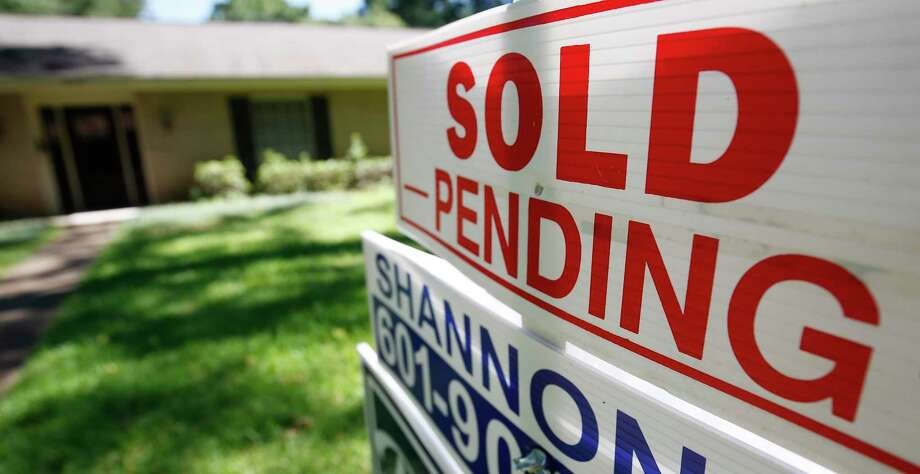"FILE - This June 13, 2019, photo shows a house with a ""sold pending"" sign fixed on the realtor's sign in northeast Jackson, Miss. On Monday, Dec. 30, the National Association of Realtors releases its November report on pending home sales, which are seen as a barometer of future purchases. (AP Photo/Rogelio V. Solis, File) Photo: Rogelio V. Solis, STF / Associated Press / Copyright 2019 The Associated Press. All rights reserved"