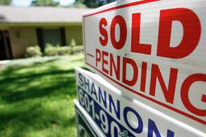 "FILE - This June 13, 2019, photo shows a house with a ""sold pending"" sign fixed on the realtor's sign in northeast Jackson, Miss. On Monday, Dec. 30, the National Association of Realtors releases its November report on pending home sales, which are seen as a barometer of future purchases. (AP Photo/Rogelio V. Solis, File)"