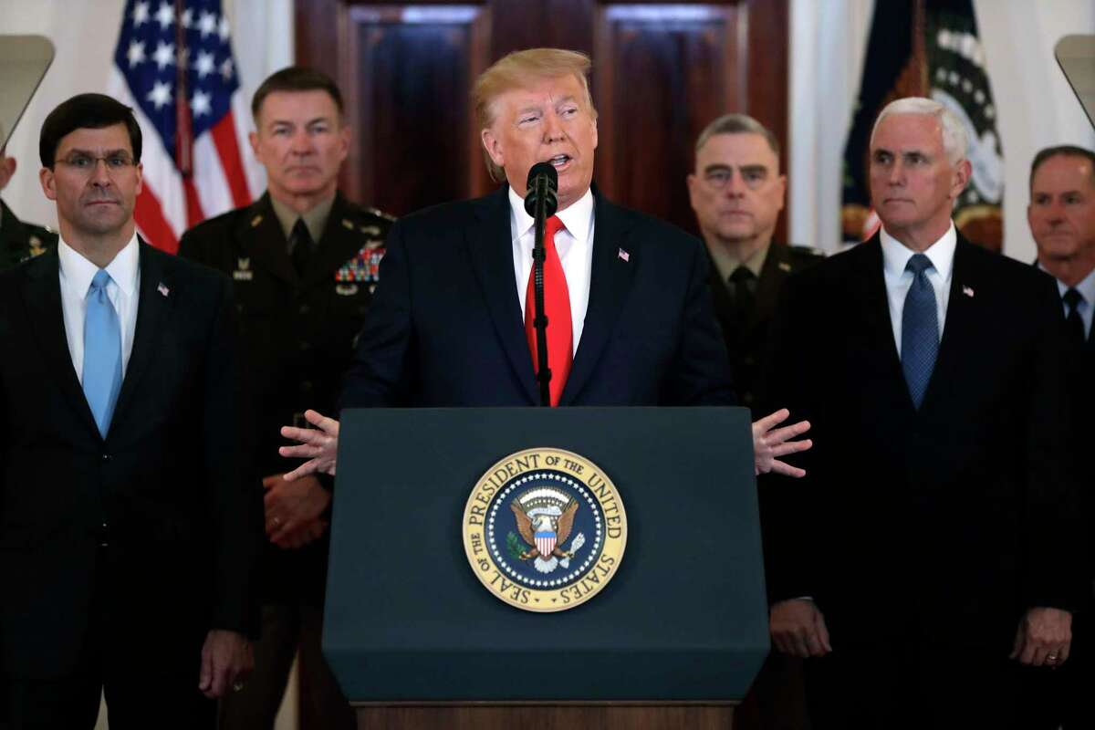 President Donald Trump addresses the nation from the White House on the ballistic missile strike that Iran launched against Iraqi air bases housing U.S. troops, Wednesday, Jan. 8, 2020, in Washington, as Vice President Mike Pence and others looks on.
