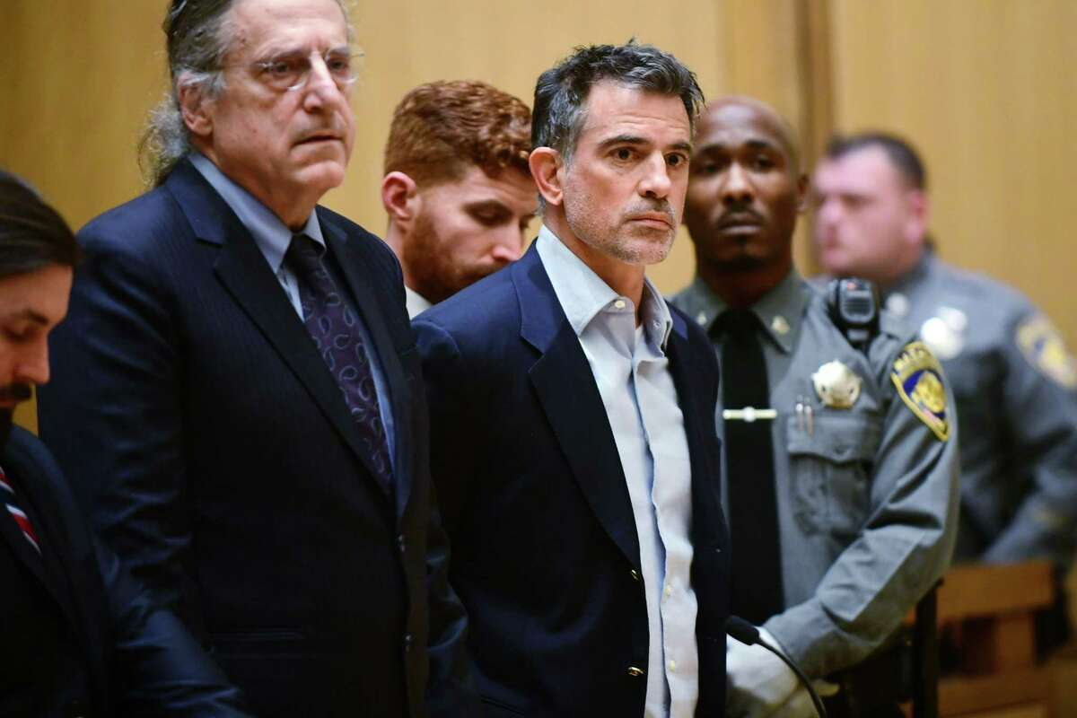 Fotis Dulos is arraigned on murder and kidnapping charges in Stamford Superior Court Wednesday, January 8, 2020, in Stamford, Conn. Dulos had been previously charged with evidence tampering in the disappearance of his wife, Jennifer Dulos. With Fotis Dulos is his attorney Norm Pattis.