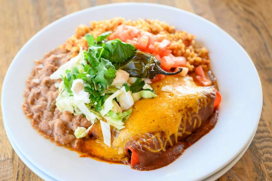 Eastside Kitchenette is offering $10 all-you-can-eat cheese enchiladas from 11 a.m. to 8 p.m. every Monday in the month of January. The dine-in only special also comes with rice and beans. Photo: Eastside Kitchenette