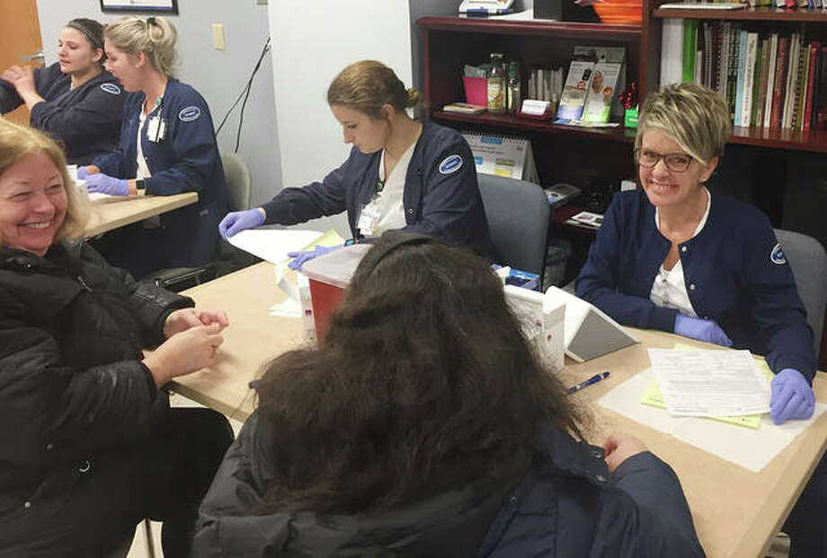 Student nurses from Lewis and Clark Community College aid participants at the 2019 Alton Memorial Hospital Heart Fair. This year's free event is planned 8:30 a.m. to noon Feb. 1 in the AMH lobby.