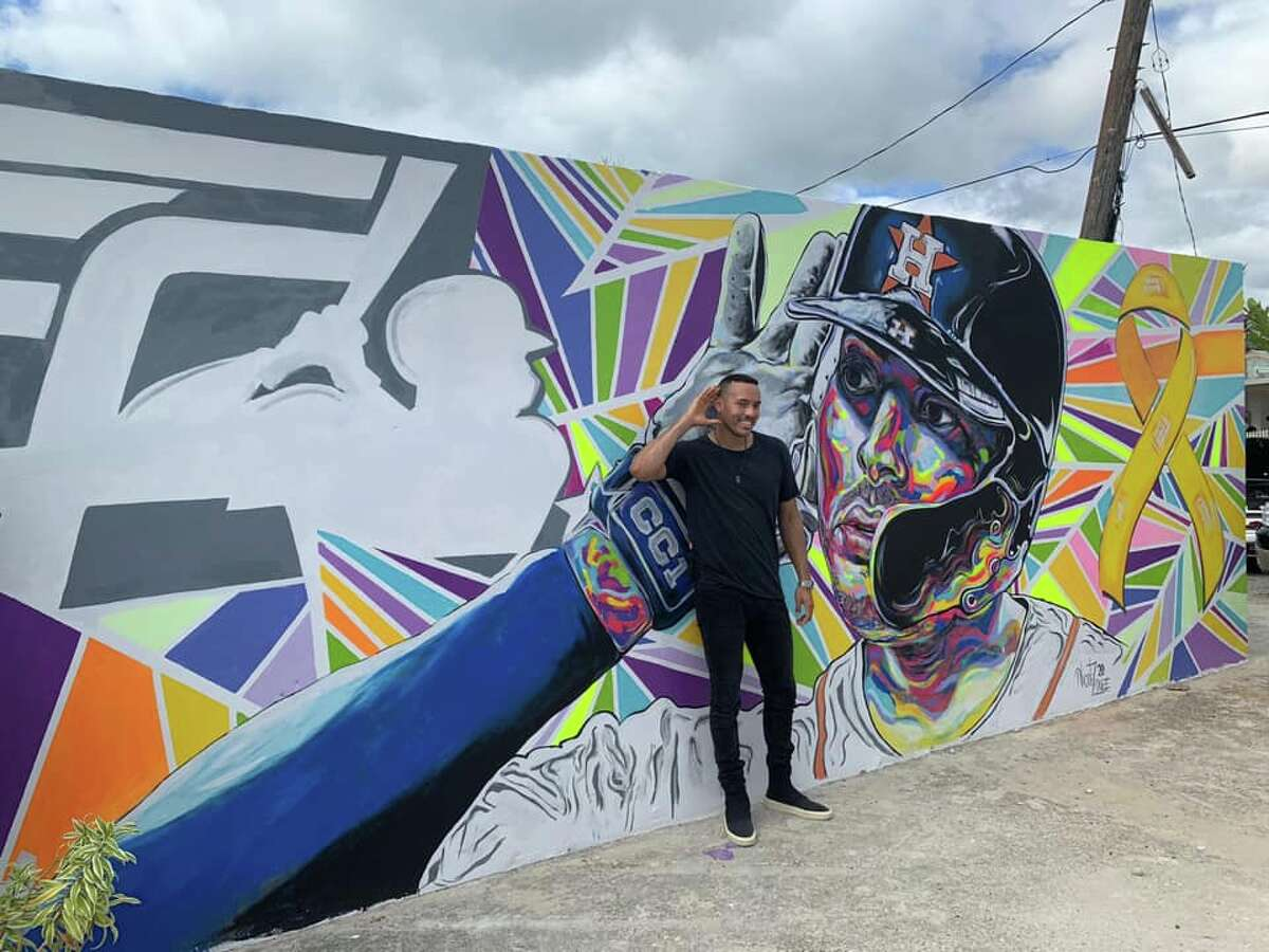 Astros shortstop Carlos Correa is pictured in front of a mural depicting himself that was unveiled Monday at El Malecón in Santa Isabel, Puerto Rico.