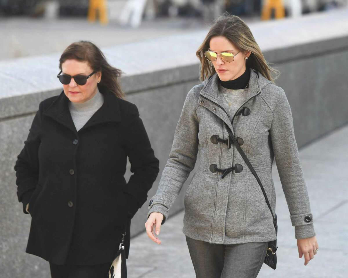 Michelle Troconis' mother and sister exit Connecticut Superior Court in Stamford, Conn. after Troconis' arraignment on a charge of conspiracy to commit murder on Wednesday, Jan. 8, 2020. Fotis Dulos, 52, was arraigned and charged with felony murder, murder and kidnapping his wife, Jennifer Dulos, who has been missing since May 24, 2019. His former girlfriend, Michelle Troconis, 45, and his former civil attorney, Kent Mawhinney, 53, were also arraigned on a charge of conspiracy to commit murder.