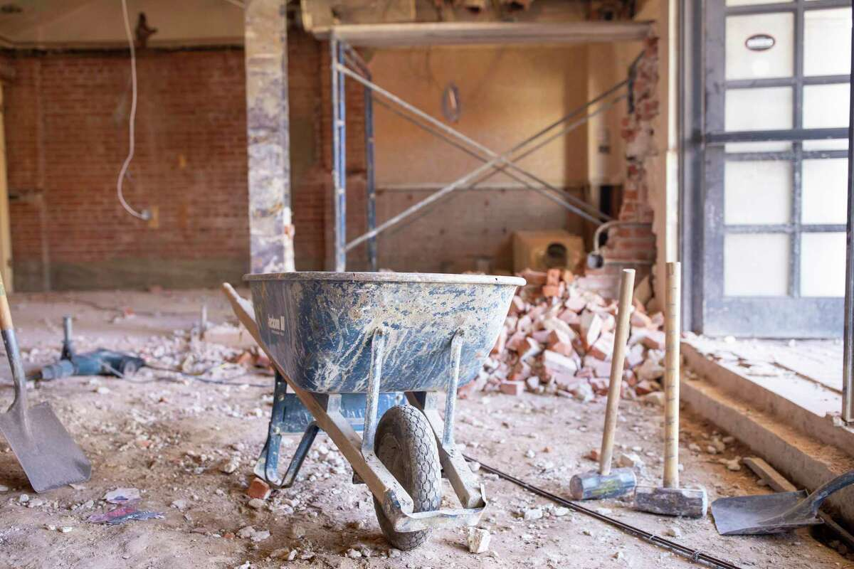 A wheel barrel and sledge hammers rest at the entrance of Crighton Theater in Conroe, Wednesday, Jan. 8, 2020. The theater is accepting donations for costs associated with the renovation which is an estimated $1.44 million.