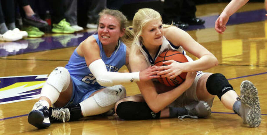 Jersey's Clare Breden (left) and CM's Claire Christeson battle for a loose ball in the second half Tuesday night in Bethalto. CM was granted a timeout on the play. Photo: Greg Shashack | The Telegraph
