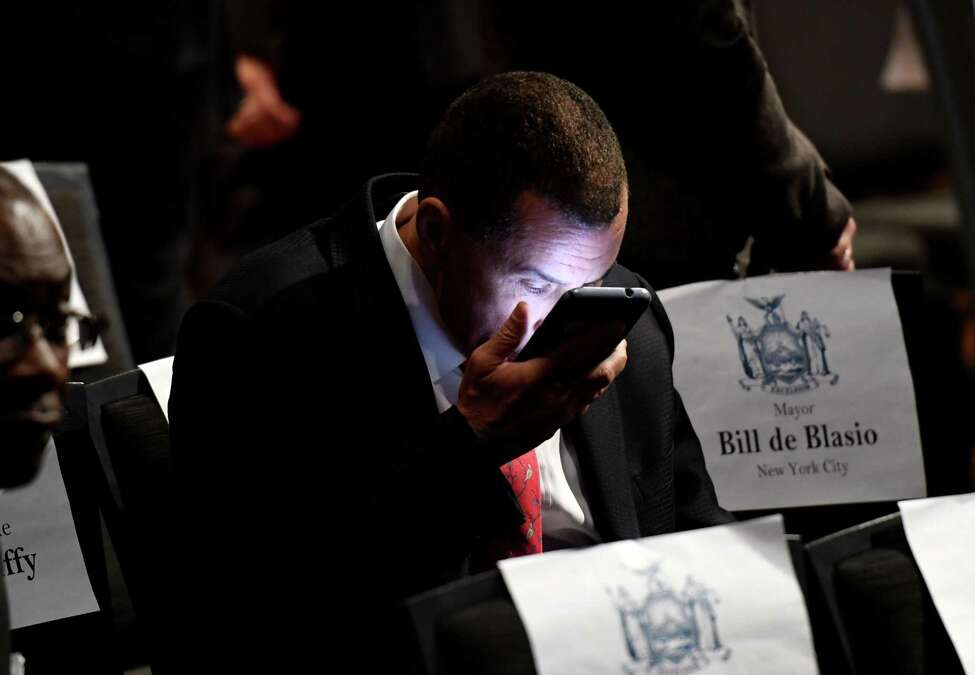 Former governor David Paterson checks his phone before the start of Gov. Andrew Cuomo's 2020 State of the State Address on Wednesday, Jan. 8, 2020, at Empire State Plaza Convention Center in Albany, N.Y. (Will Waldron/Times Union)
