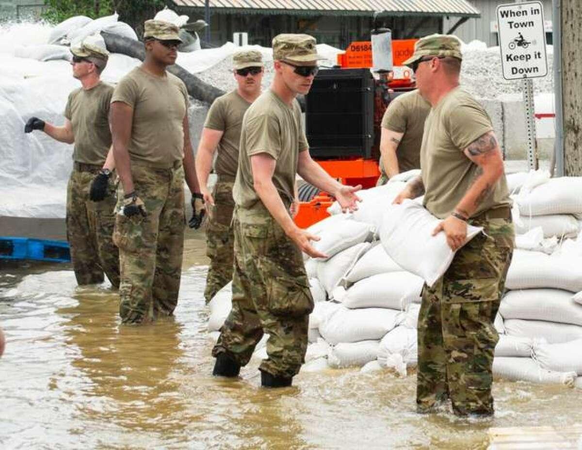 Soldiers of Battery B, 2nd Battalion, 123rd Field Artillery conduct sandbag operations in Grafton last summer.