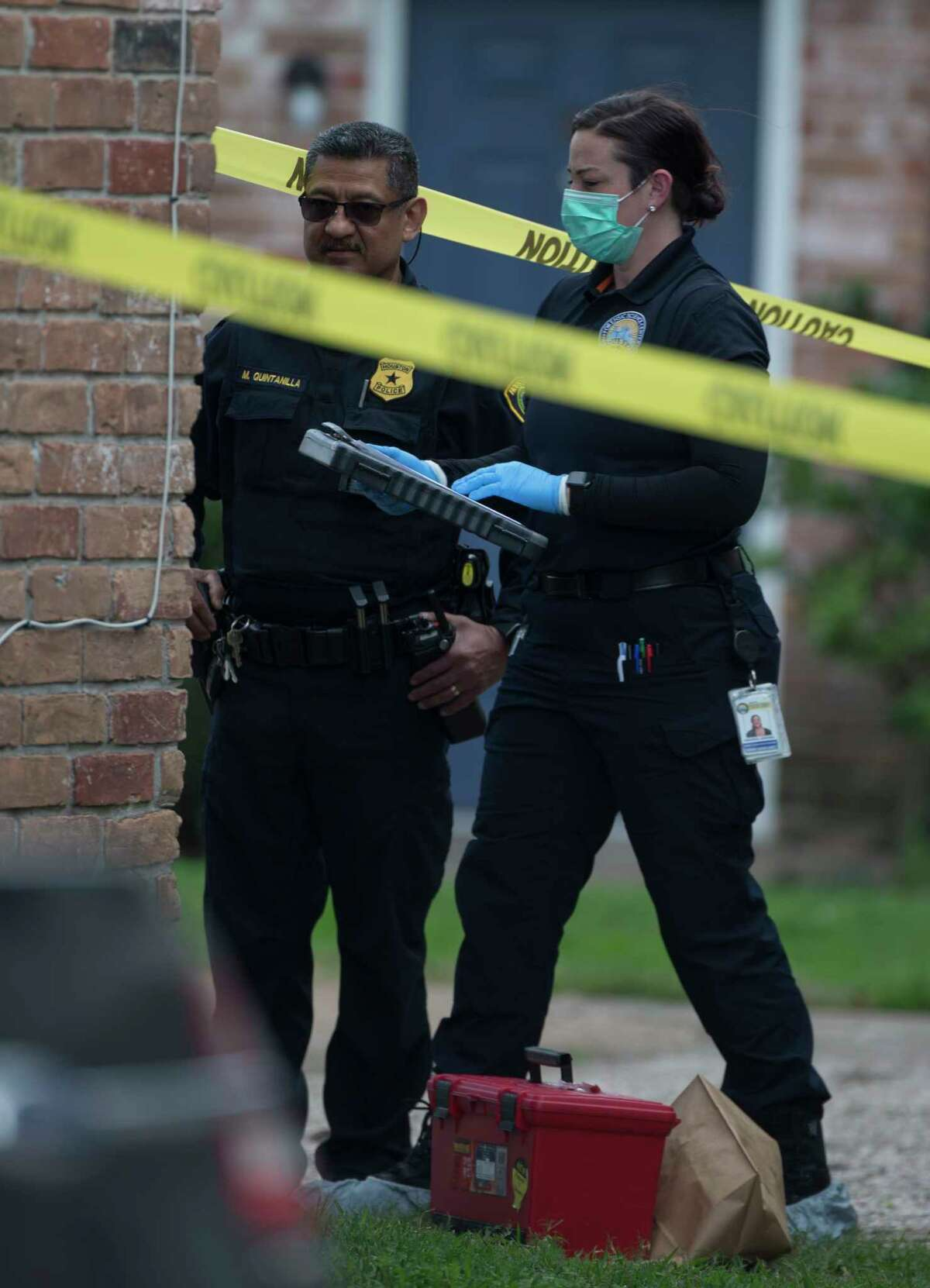 Houston Police Department Crime Scene Unit investigators work on a shooting scene on the 11800 block of Algonquin Drive on Wednesday, Jan. 8, 2020, in Houston. One male died and another was taken to a hospital in unknown condition.