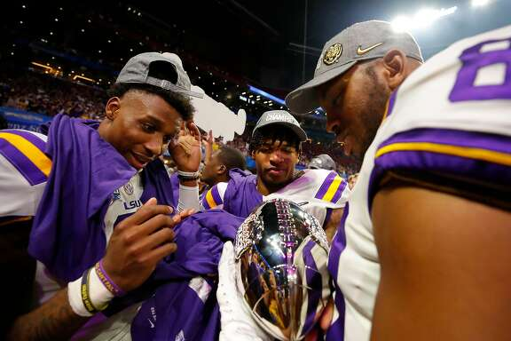 ATLANTA, GEORGIA - DECEMBER 28: Wide receiver Terrace Marshall Jr. #6 of the LSU Tigers and tight end Jamal Pettigrew #80 of the LSU Tigers celebrate their win over the Oklahoma Sooners during the Chick-fil-A Peach Bowl at Mercedes-Benz Stadium on December 28, 2019 in Atlanta, Georgia. (Photo by Todd Kirkland/Getty Images)