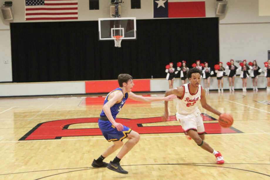 Rosehill Christian beat Providence Classical 68-24 in the TAPPS 3A District 6 opener, Jan. 7, at Rosehill Christian High School. Caleb Ceasar, right, scored 25 points in the win. Photo: File Photo/Alvaro Montano