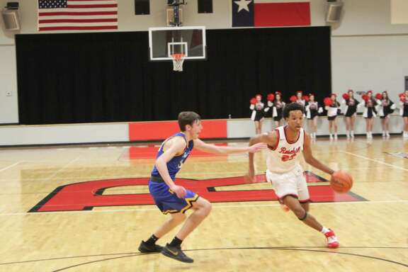 Rosehill Christian beat Providence Classical 68-24 in the TAPPS 3A District 6 opener, Jan. 7, at Rosehill Christian High School. Caleb Ceasar, right, scored 25 points in the win.