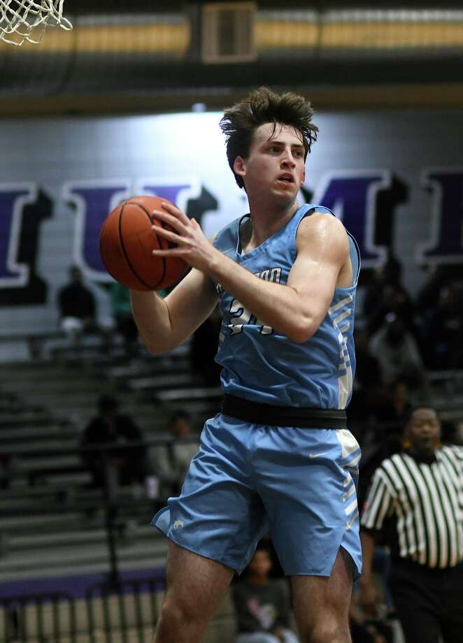 Kingwood senior Walker Blaine (24) hit the game winning shot after securing a rebound. The Mustangs defeated Humble 60-58. Photo: Jerry Baker, Houston Chronicle / Contributor / Houston Chronicle