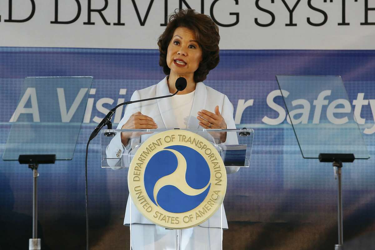 FILE - In this Sept. 12, 2017 file photo, U.S. Transportation Secretary Elaine Chao announces new voluntary safety guidelines for self-driving cars during a visit to an autonomous vehicle testing facility at the University of Michigan, in Ann Arbor, Mich. The Trump administration announced its most recent round of guidelines for autonomous vehicle makers, continuing to rely on the industry to police itself despite calls for specific regulations. Chao announced the proposed guidelines in a speech Wednesday, Jan. 8, 2020 at the CES gadget show in Las Vegas, saying in prepared remarks that