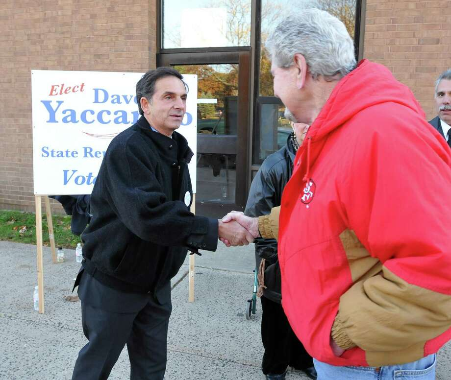 Then Republican candidate Dave Yaccarino shakes hands with a voter outside the polling place in North Haven in 2010. Photo: Hearst Connecticut Media File Photo