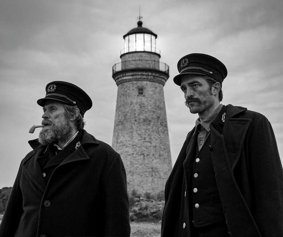 "This image released by A24 Films shows Willem Dafoe, left, and Robert Pattinson in a scene from ""The Lighthouse."" Photo: Eric Chakeen, HONS / AP / 2019 A24 Films"