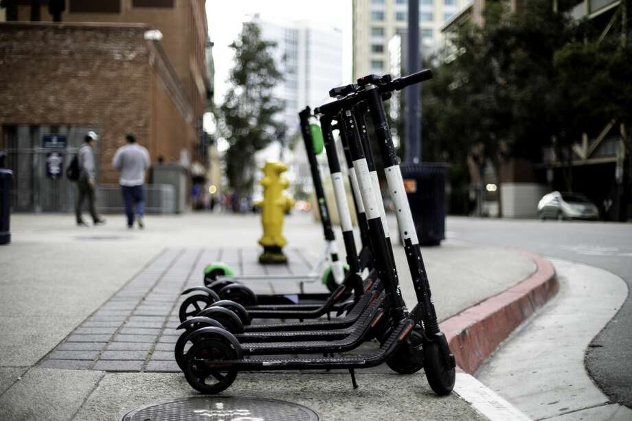 E-scootercompany Go X is under fire after forging its own permit and owing $233,800 to the city in unpaid parking citations. Photo: Garrett Aitken/Getty Images/iStockphoto