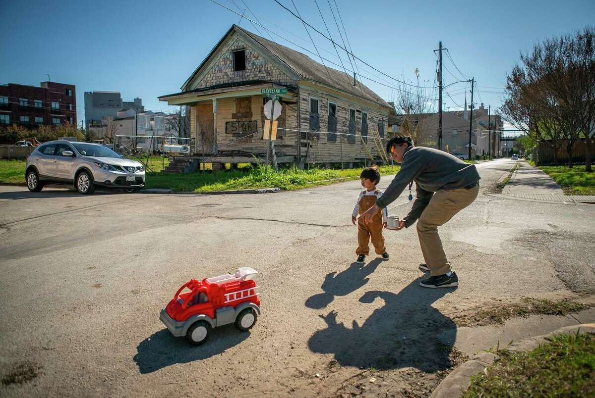 Ben Temcharoen talks to his two-year-old son, Hayden, as they take a walk around their block in the Freedman's Town area of the Fourth Ward just west of downtown Houston, Wednesday, Jan. 8, 2020. Temcharoen bought his 2001-built home in the neighborhood in 2006 and has lived there since, enjoying the ability to walk or bike to work in downtown Houston.