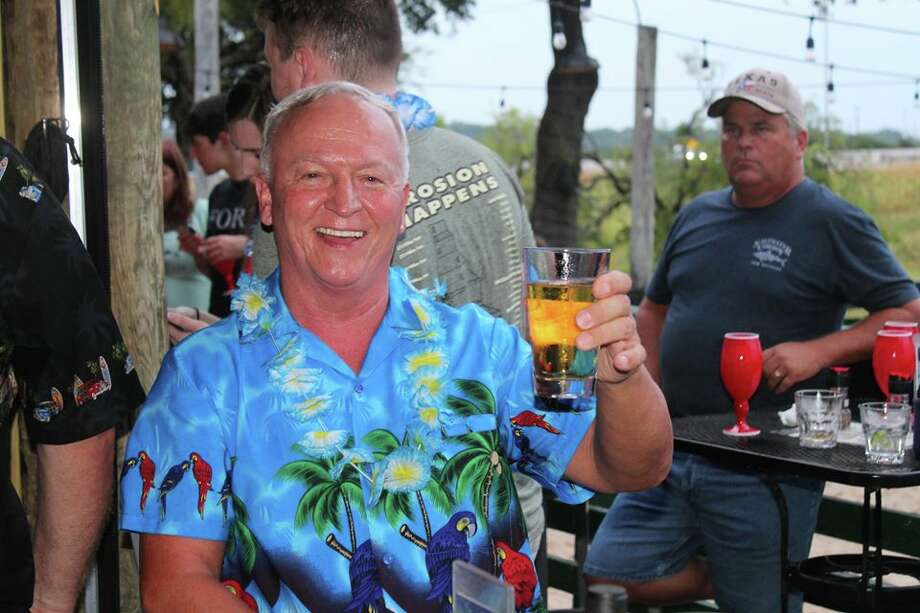 "Every month, nearly 300 hardcore Jimmy Buffett fans in San Antonio get together at a local bar, sip on a few happy hour margaritas and celebrate the carefree, laid-back tropical lifestyle the ""It's Five O' Clock Somewhere"" singer created. Photo: Facebook: San Antonio Parrot Head Club"