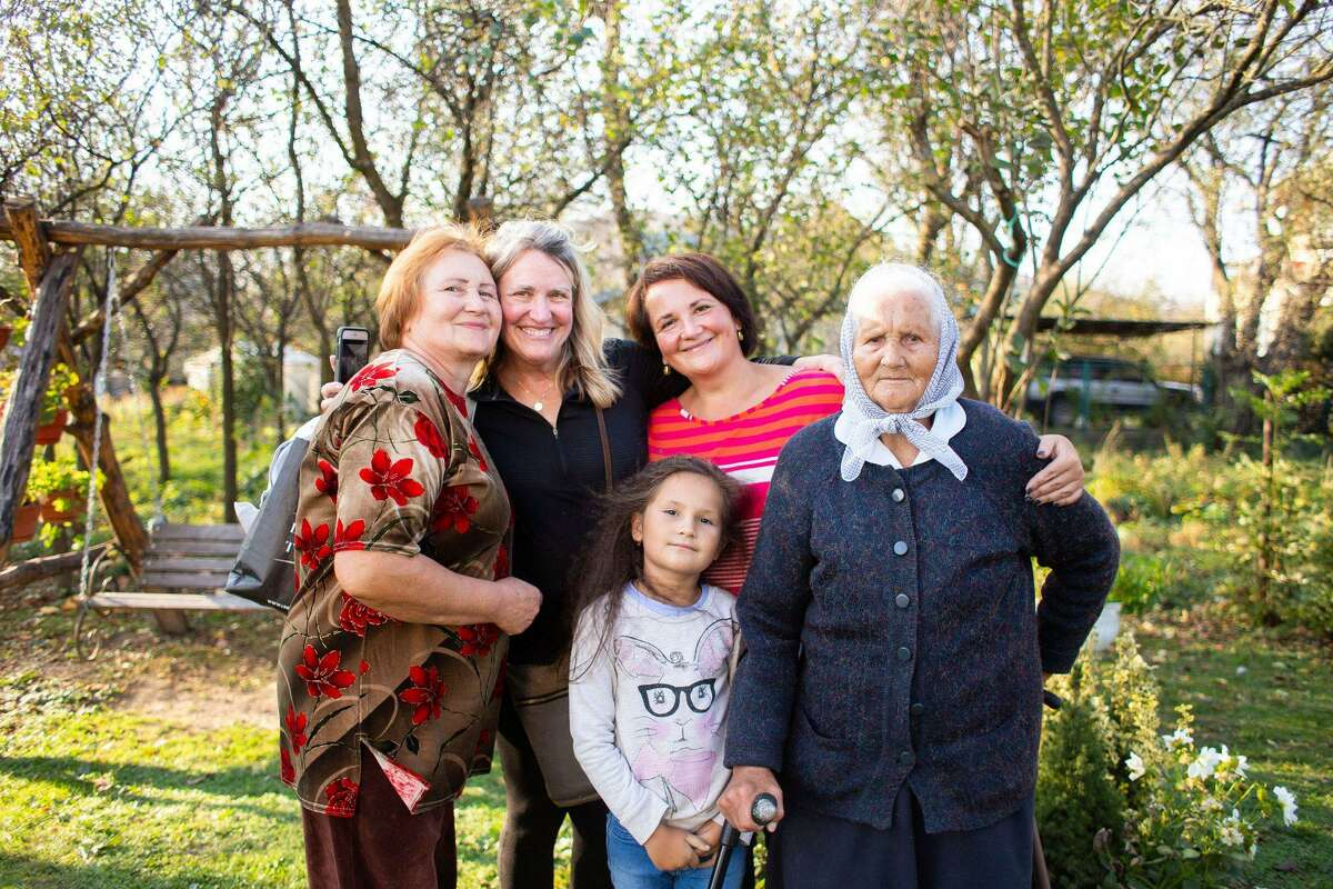 Peace Corps volunteer Leslie Nolan, second from left, with Oksana Semegen, head of the organizational department of the Nadvirna City Council, Oksana's mother, grandmother and daughter, in Nadvirna, Ukraine.