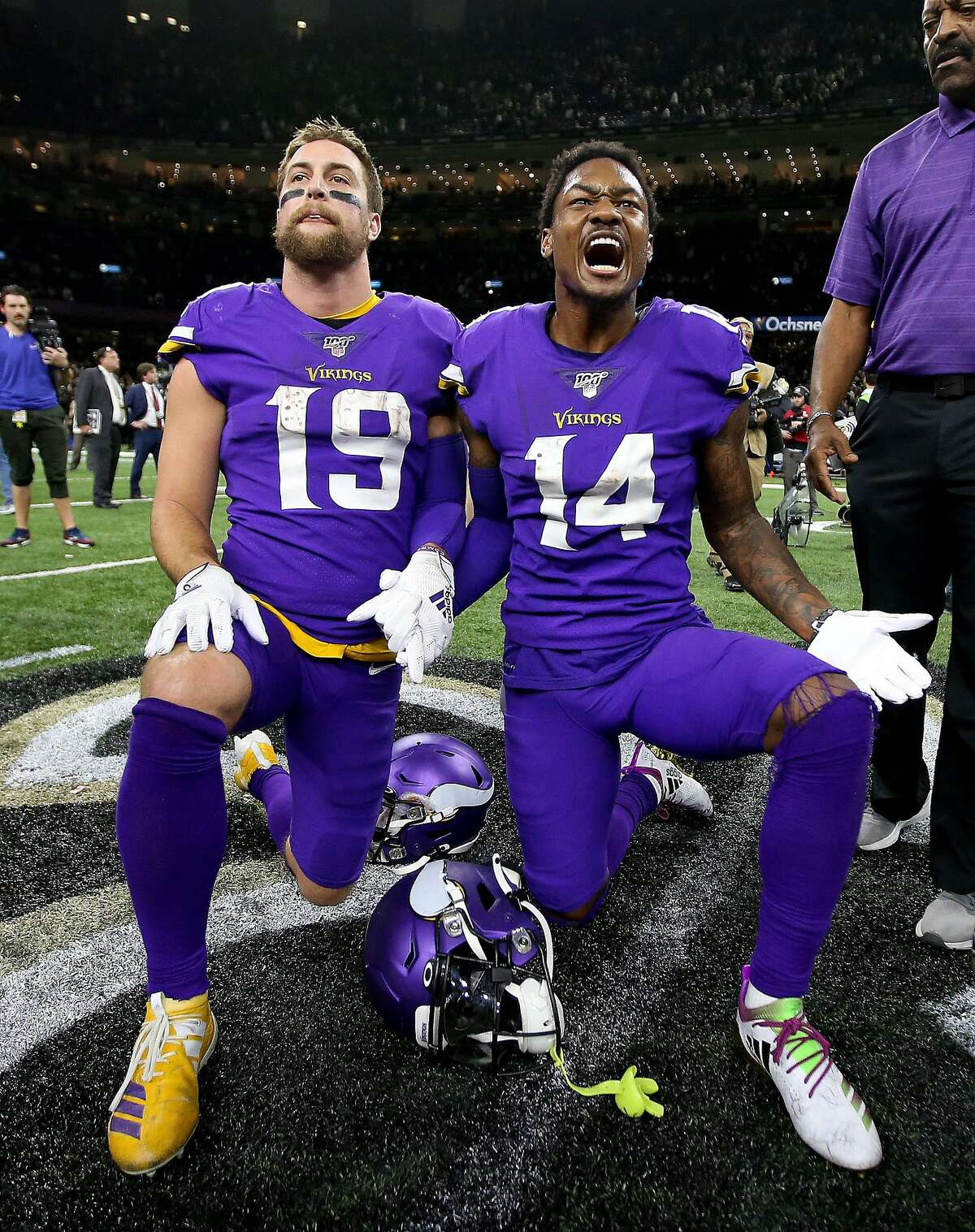 NEW ORLEANS, LOUISIANA - JANUARY 05: Adam Thielen #19 and Stefon Diggs #14 of the Minnesota Vikings celebrates after winning the NFC Wild Card Playoff game against the New Orleans Saints at Mercedes Benz Superdome on January 05, 2020 in New Orleans, Louisiana. (Photo by Jonathan Bachman/Getty Images)