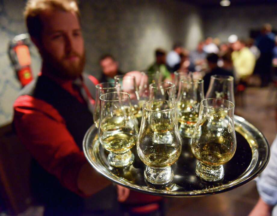 Corey Farmer serves American whiskeys during a tasting at Bar 1919. Photo: Robin Jerstad /Contributor File Photo