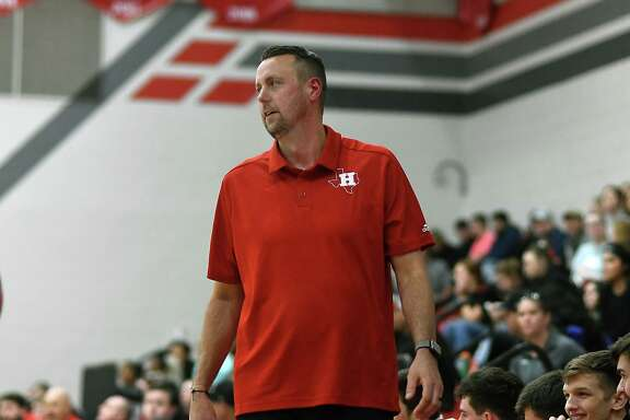 Huffman Hargrave Head Boys Basketball Coach Scott Barrett leads his team against Huntington in the fourth quarter of their district matchup at Hargrave High School on Jan. 7, 2020.